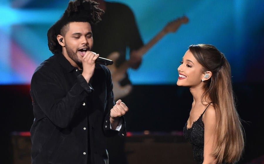 The Weeknd and Ariana Grande perform onstage at the 2014 American Music Awards at Nokia Theatre L.A. Live on Nov. 23, 2014 in Los Angeles.